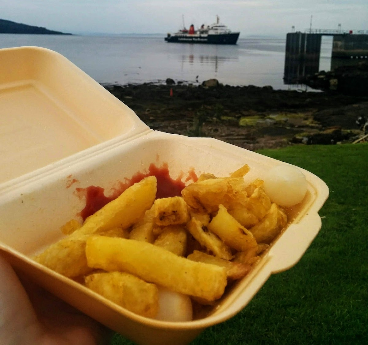 chips on arran with ferry in the background